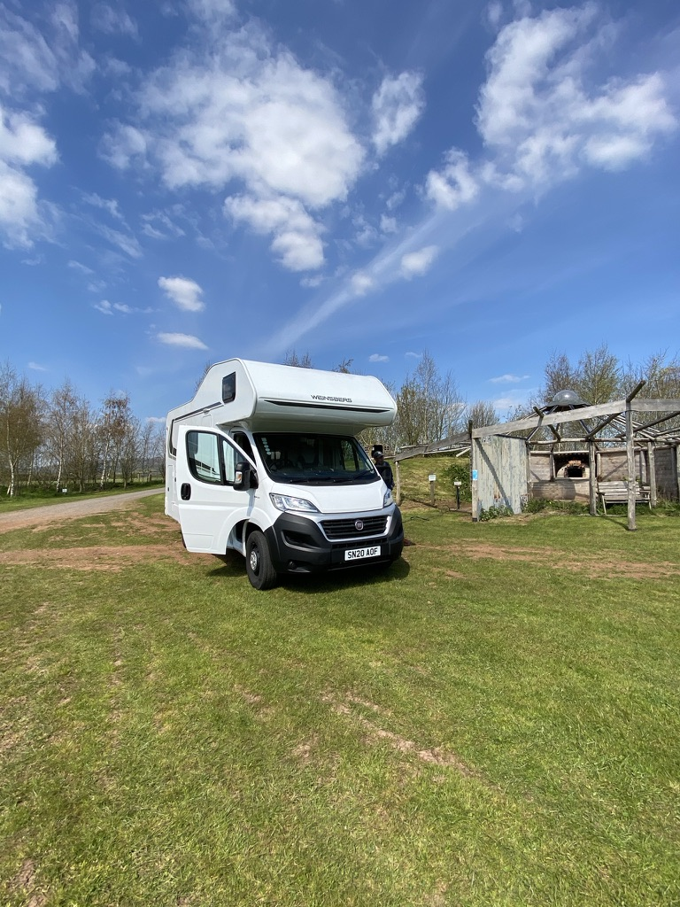 A hired motorhome parked up at a campsite in Dorset