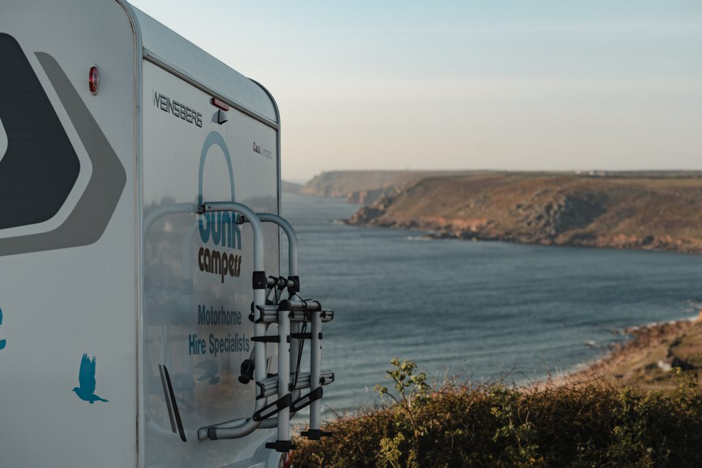 Bunk Campervan looks over the coast of Cornwall