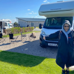 A woman embracing the great outdoors on her motorhome holiday