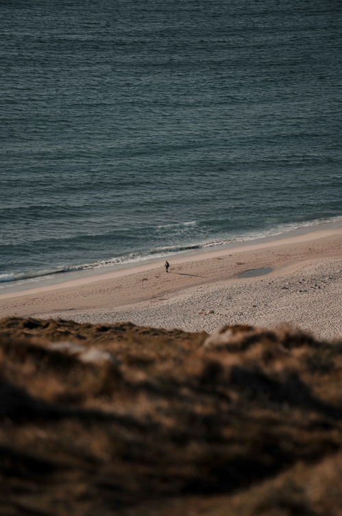 A lone walker at Land's End, the most southernly point of the UK