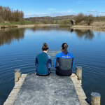 Swimmers taking in the view from a lake in Wales