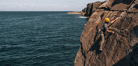 A thrill seeker taking on the vertical cliffs in County Clare with Climb-it