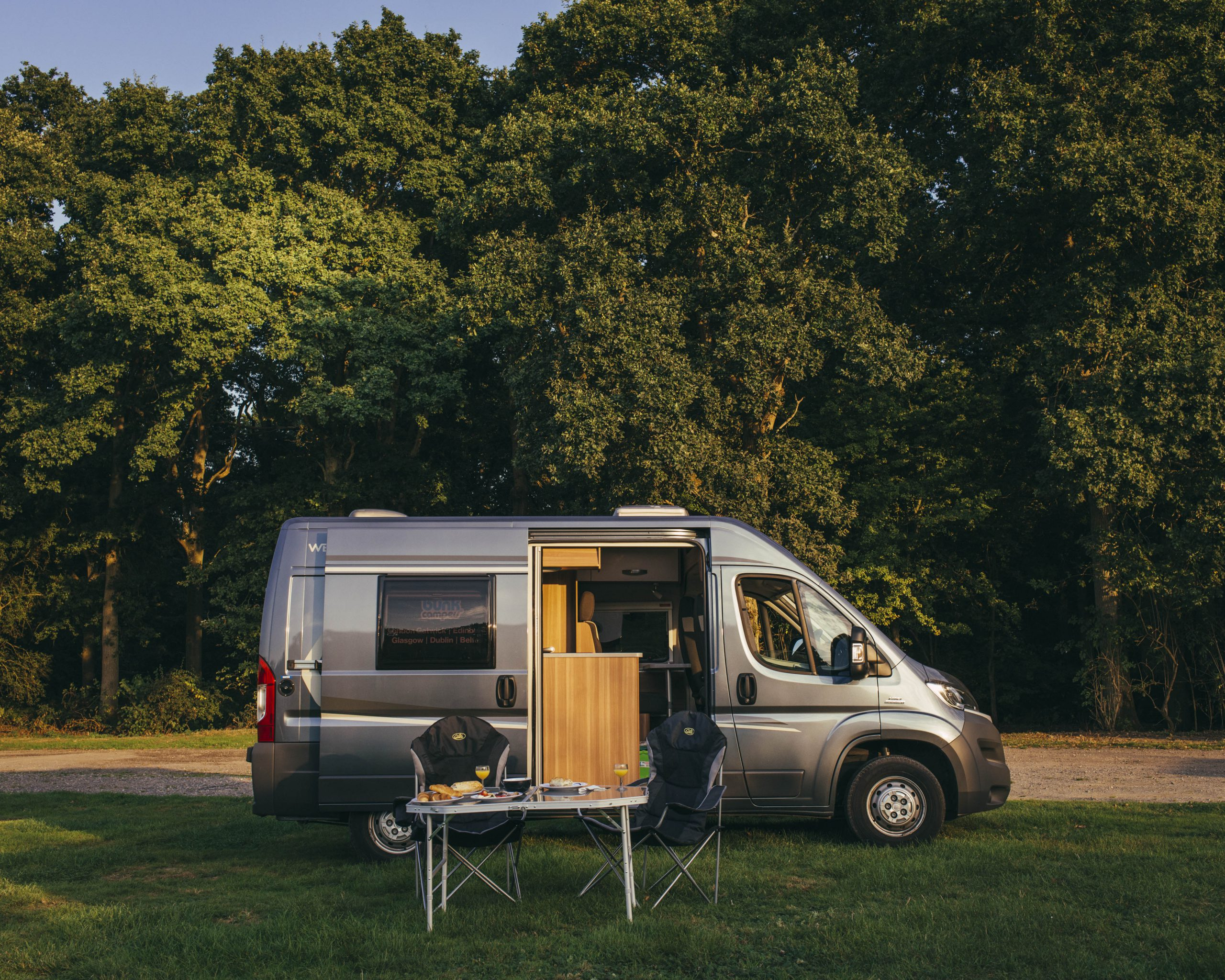 Camping in a motorhome during sunset